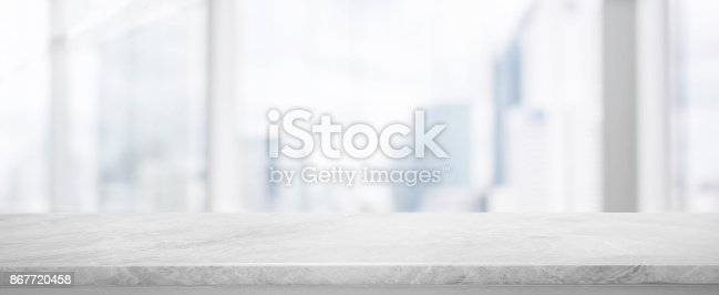 istock White Stone table top and blur glass window wall building banner background with vintage filter - can used for display or montage your products. 867720458