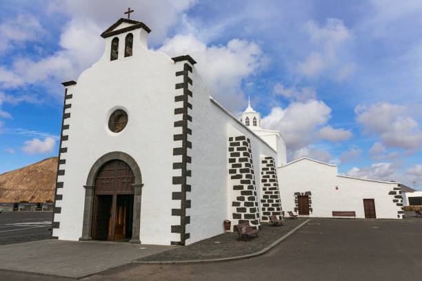 White stoned church in a wide angle view and a cloudy morning in Lanzarote, Canary Islands, Spain stock photo