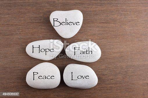 182362845 istock photo White stones with love, believe, faith, hope, peace word 494505532