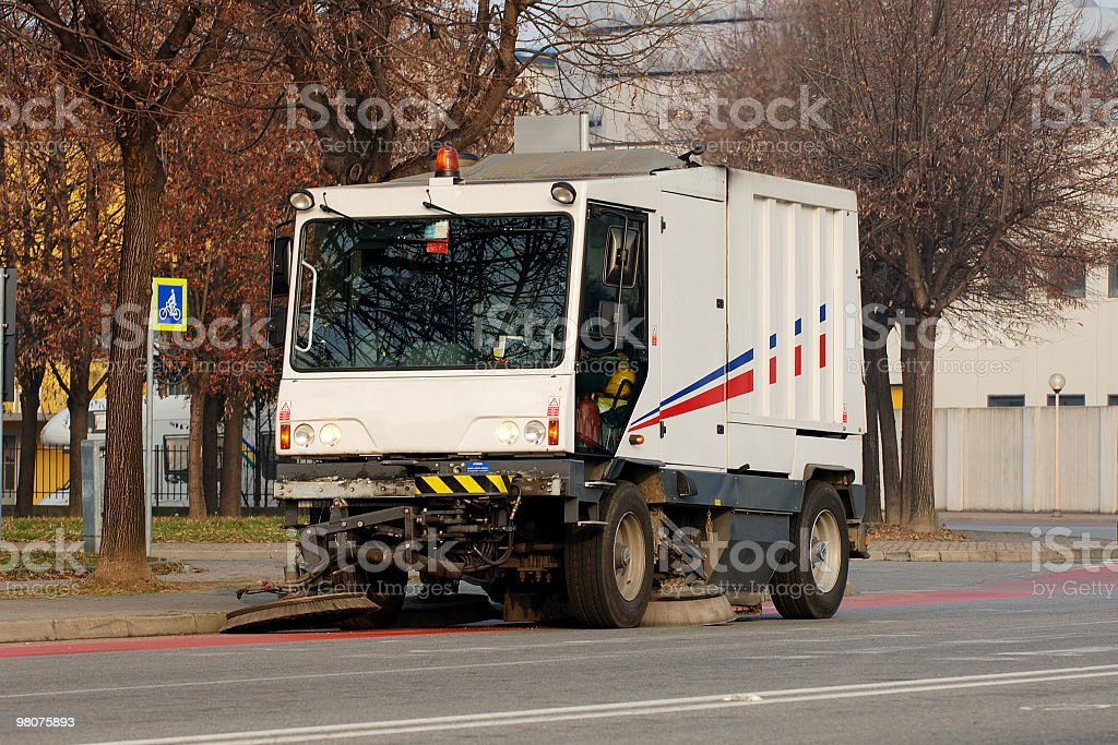 White street cleaning vehicle at work royalty-free stock photo
