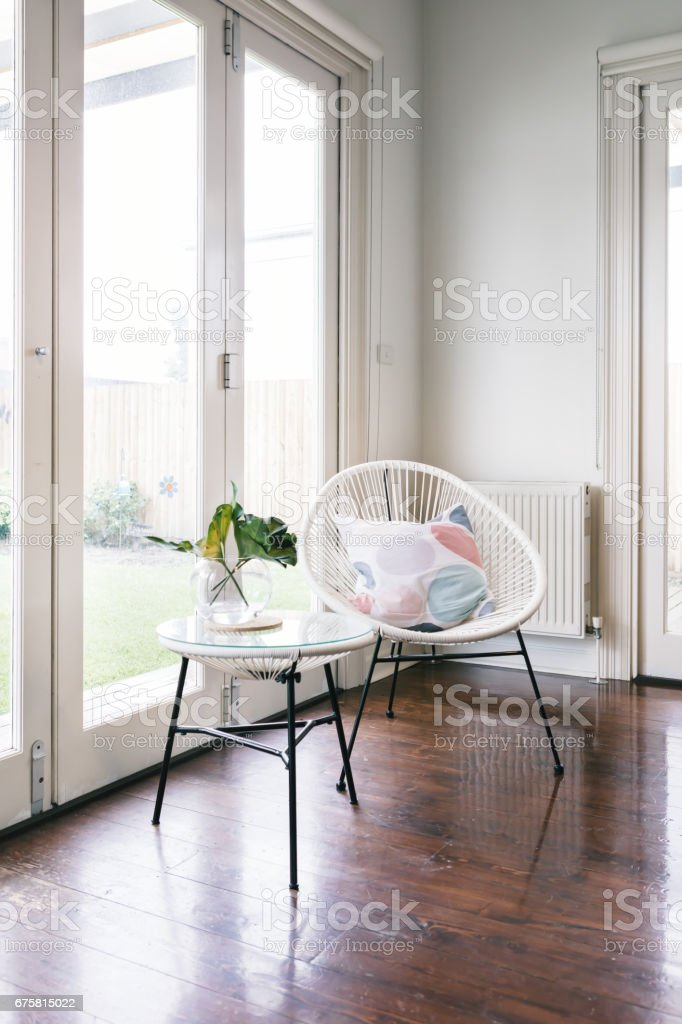 White string style occasional chair and matching side table stock photo