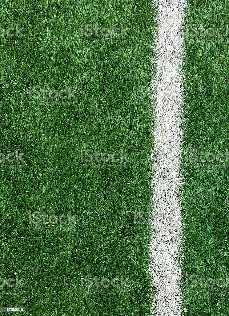 White Stripe Line on Green Soccer Field from Top View stock photo