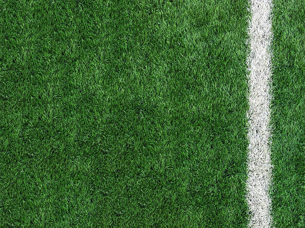 White Stripe Line on The Green Soccer Field Top View White Stripe Line on Artificial Green Soccer Field as Copyspace to input Text from Top View used as Template turf stock pictures, royalty-free photos & images