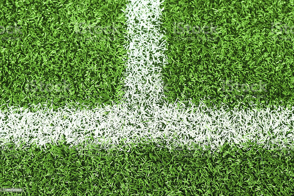 White stripe on green soccer field royalty-free stock photo