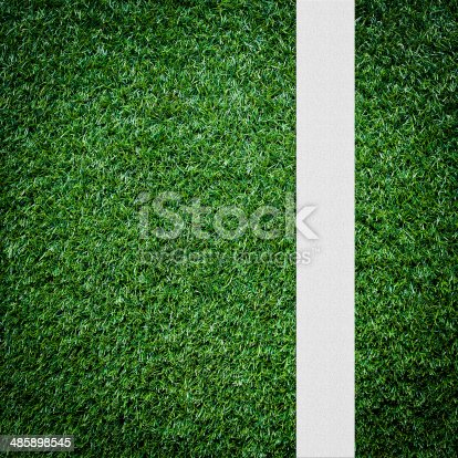 637298374istockphoto White stripe on the green soccer field from top view 485898545