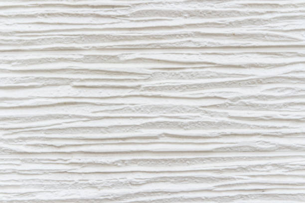 White striped background. High detailed fragment of white stone wall. stock photo