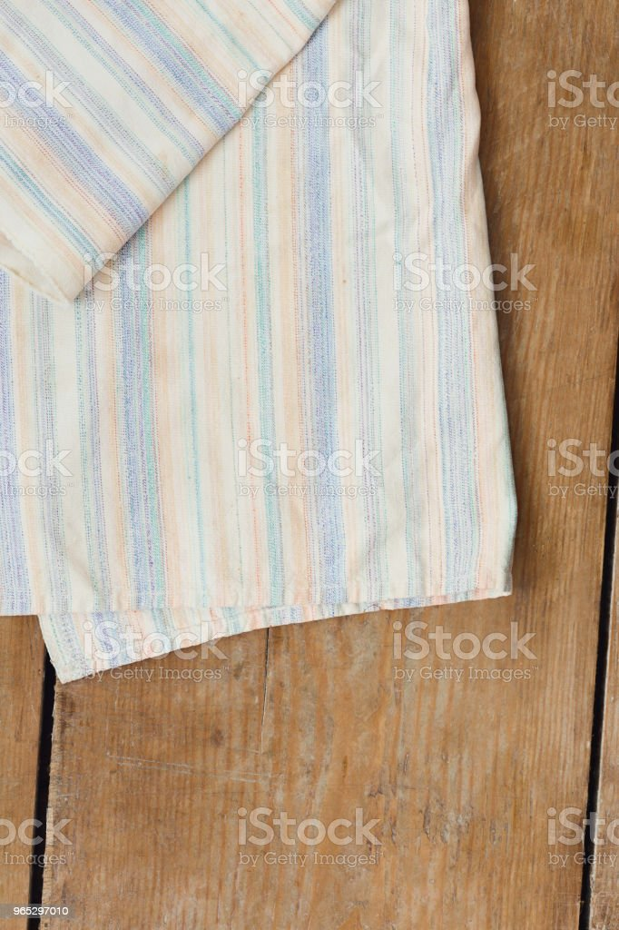 White striped kitchen napkin on rustic wooden kitchen table, top view zbiór zdjęć royalty-free