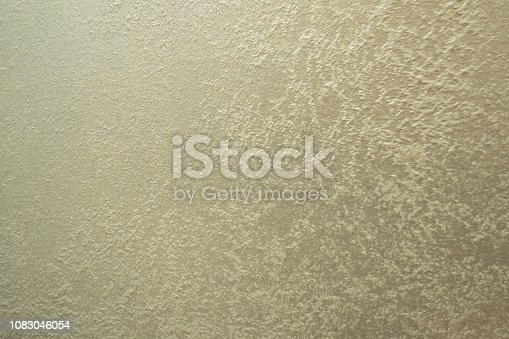 1138442636istockphoto white Structural plaster on black wall 1083046054