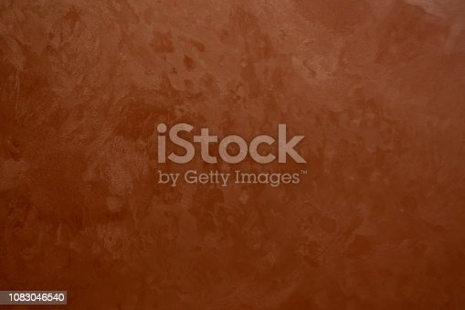 1138442636istockphoto white Structural plaster on black wall 1083046540