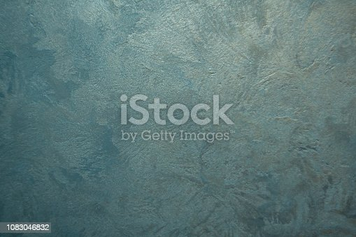 1138442636istockphoto white Structural plaster on black wall 1083046832