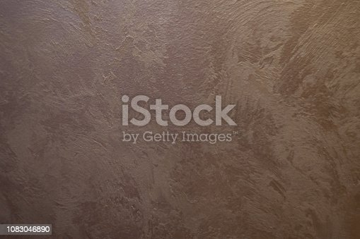 1138442636istockphoto white Structural plaster on black wall 1083046890