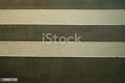 1138442636istockphoto white Structural plaster on black wall 1083057252