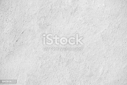 closeup of old white stucco clay wall, rough surface background with abstract grain detail or backdrop in architectural material concept
