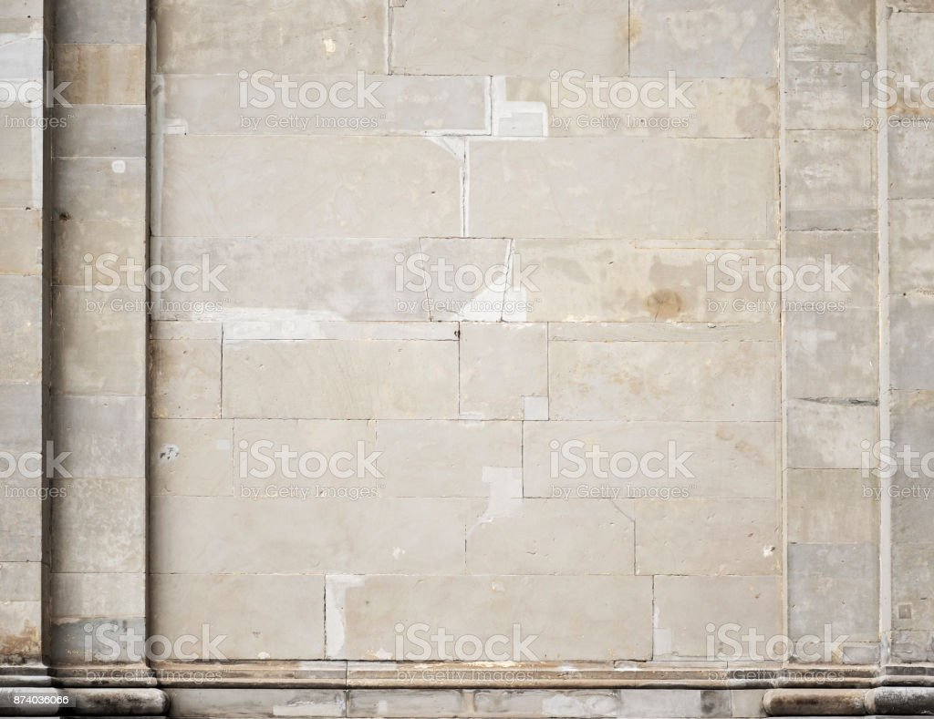 white stucco wall of historical building stock photo