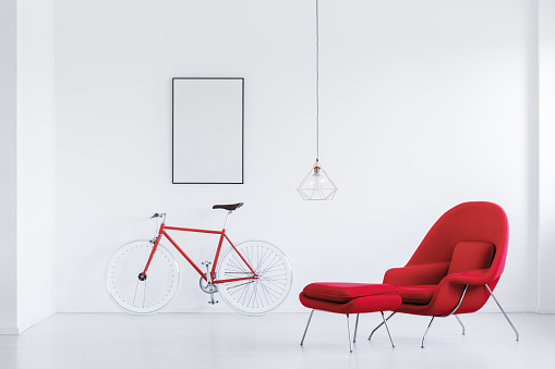 istock White studio with red armchair 876931632
