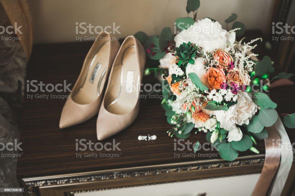 White stylish wedding shoes for bride. Close-up stock photo