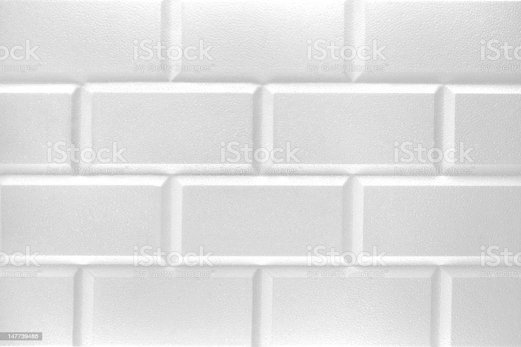 white styrofoam brick wall stock photo