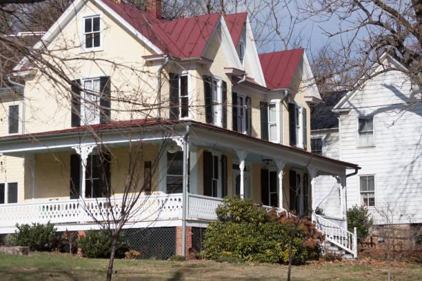 White suburban victorian home stock photo
