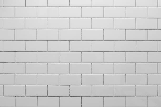 White subway tile without grout White subway tile, freshly installed, waiting for grout. underground stock pictures, royalty-free photos & images