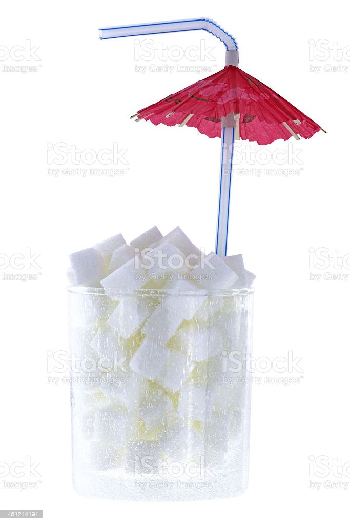 White sugar cubes with Cocktail Umbrella stock photo