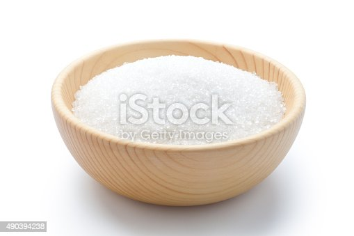 white sugar in a wooden bowl on white background.