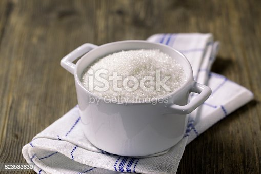 A cup of white granulated sugar