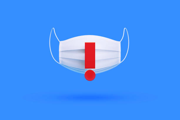 White Surgical Mask with Red Exclamation Point over Blue Background White surgical mask with red exclamation point over blue background, Horizontal composition. Illness prevention concept. covid icon stock pictures, royalty-free photos & images