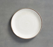 white Swirl Melamine Plate with dark gray background