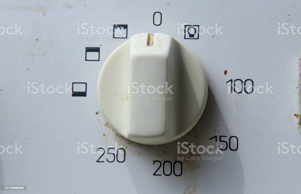 A white switch on oven for regulating warm in the inside oven stock photo