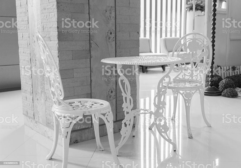 white table and chair sculpturing tracery stock photo