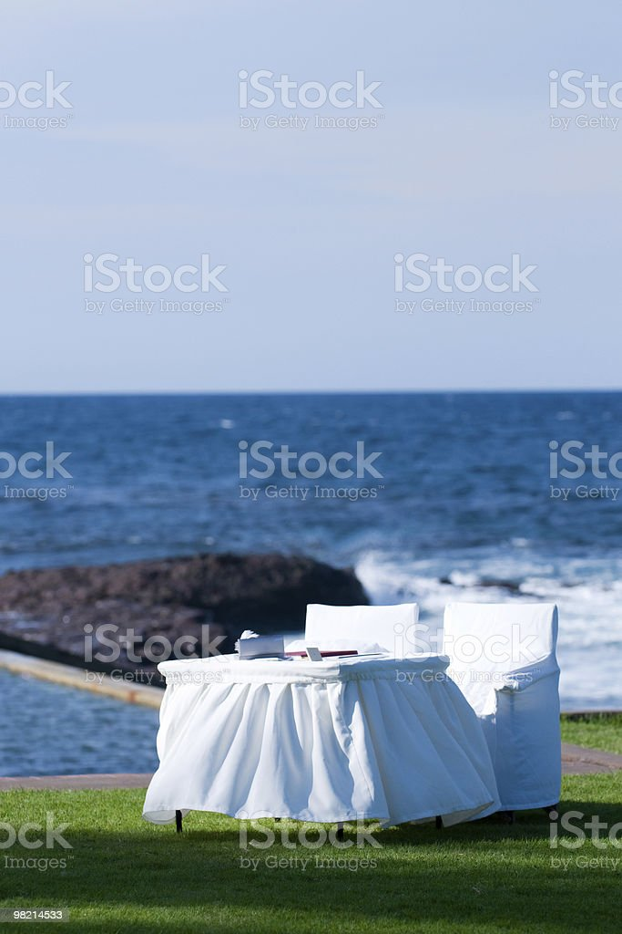 White table and chairs by the seaside royalty-free stock photo