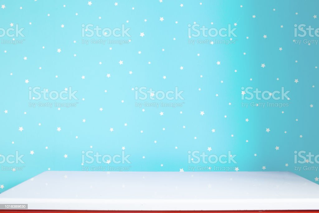 white table and light blue wall in nursery stock photo