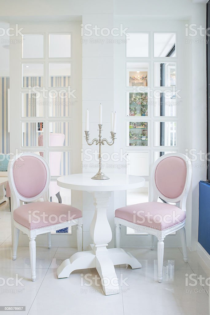 White Table And Pink Chair With Candle In Living Room Stock Photo
