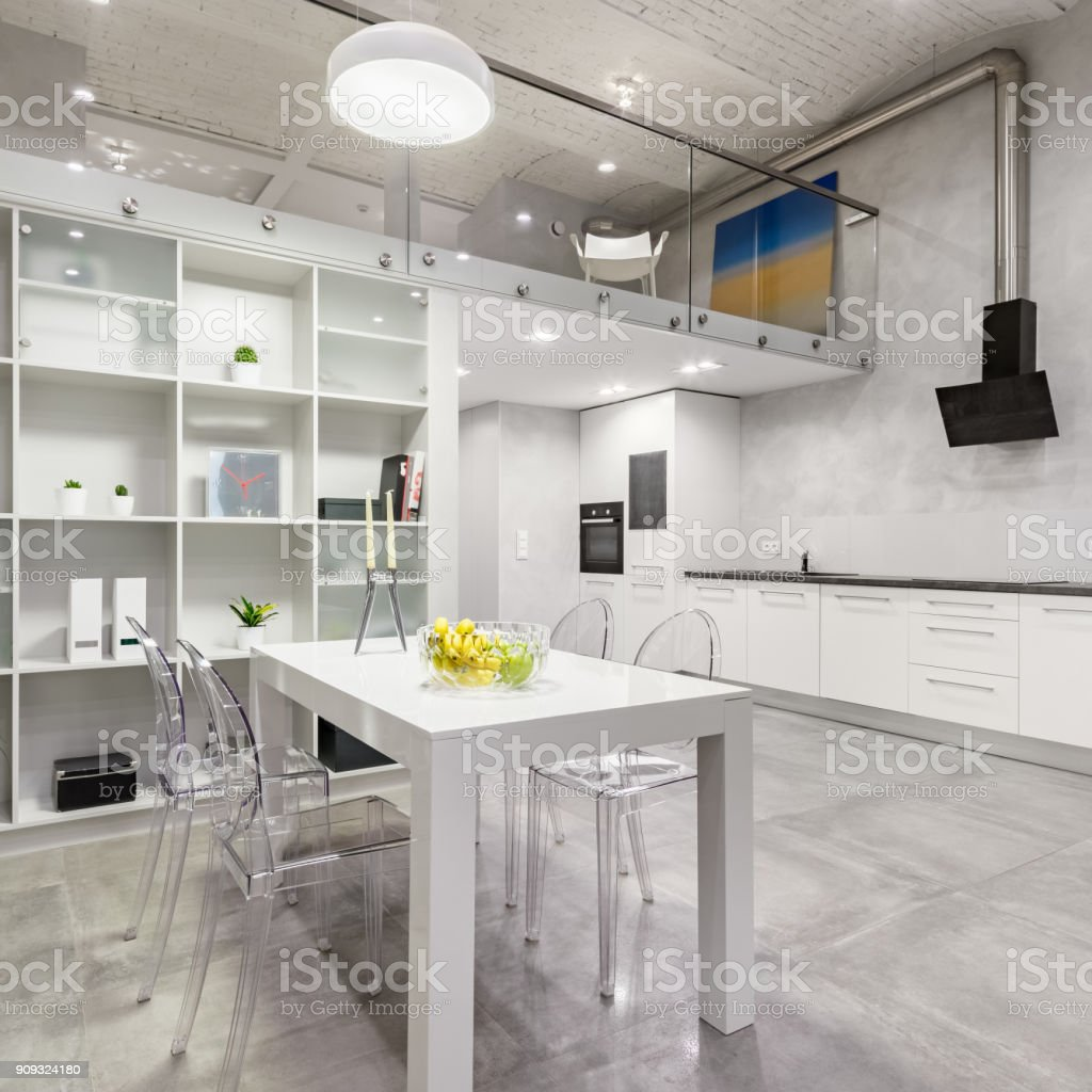 White table and transparent chairs stock photo