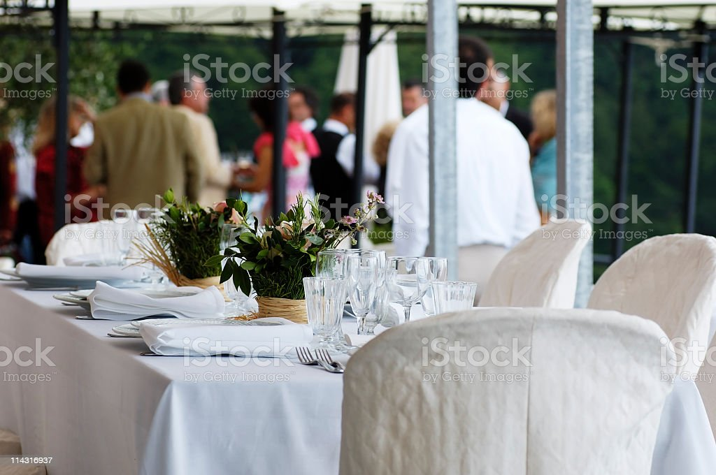 A white table decorated for a wedding reception royalty-free stock photo