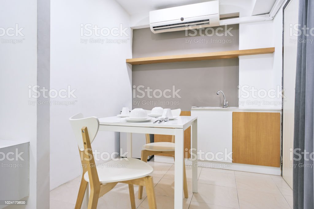White Table Set With Wooden Chairs Modern Kitchen Concept For Apartment Interior Stock Photo Download Image Now Istock
