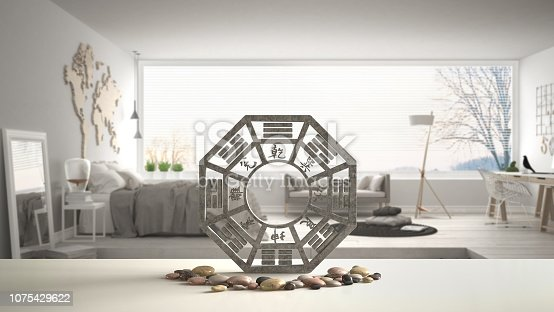 White table shelf with bagua and pebble stone, white scandinavian bedroom with big panoramic window, zen concept interior design, feng shui template idea background