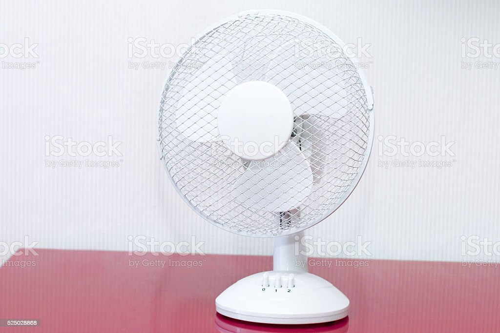 White table ventilator with spinning blades closeup stock photo