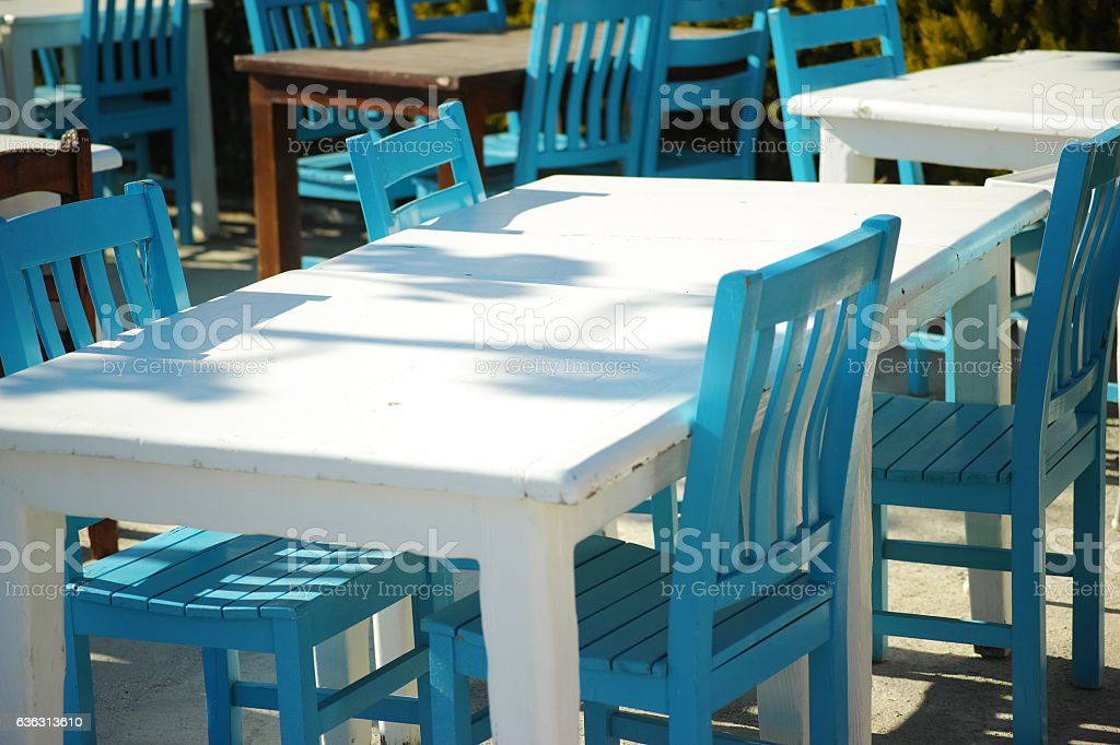 White Table With Blue Chairs Fisherman's Place In Bodrum stock photo