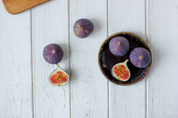 White table with fig fruit over it. stock photo