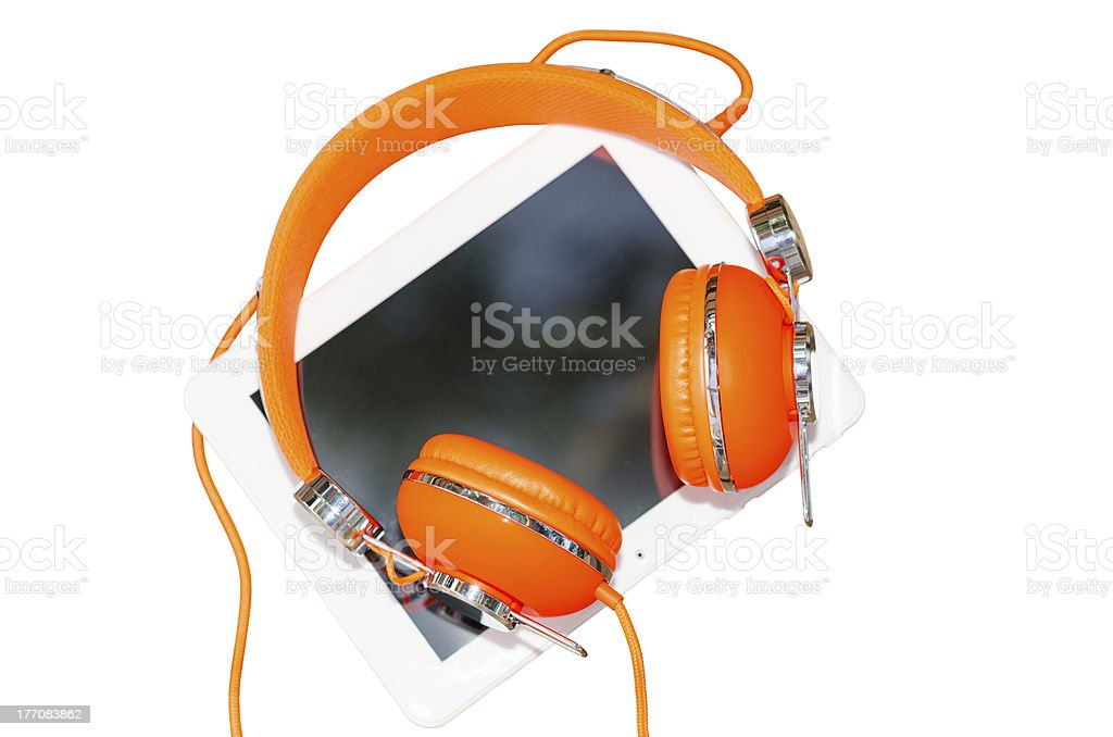 White tablet computer with orange headphones isolated royalty-free stock photo