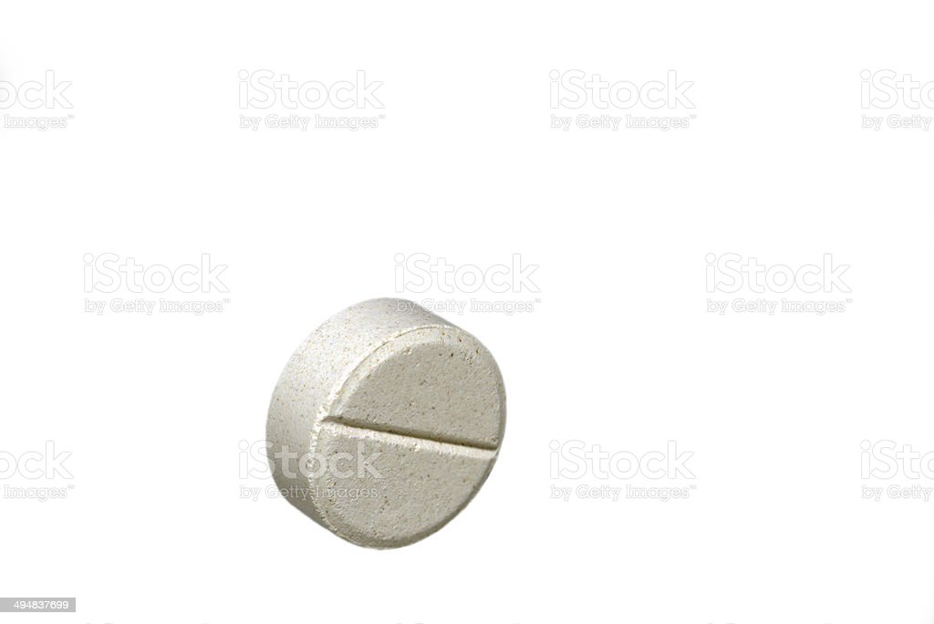 White tablet pill isolated on white background stock photo