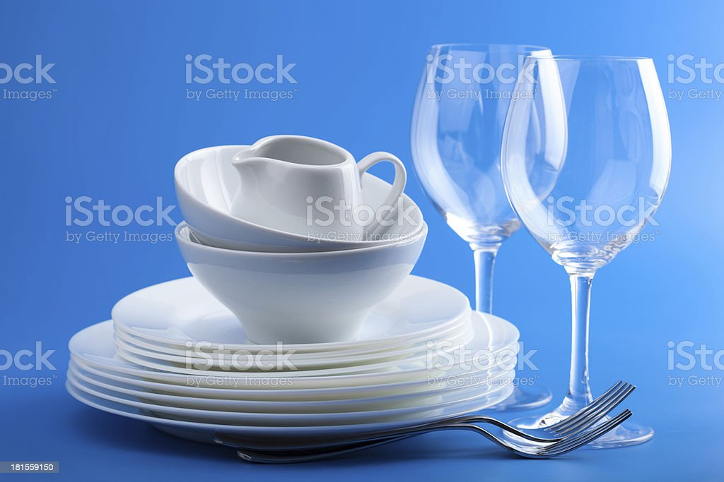 white tableware over blue background royalty-free stock photo
