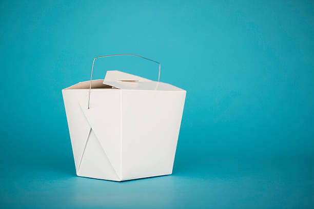 White take out box on a blue background White take out box on a blue background chinese takeout stock pictures, royalty-free photos & images