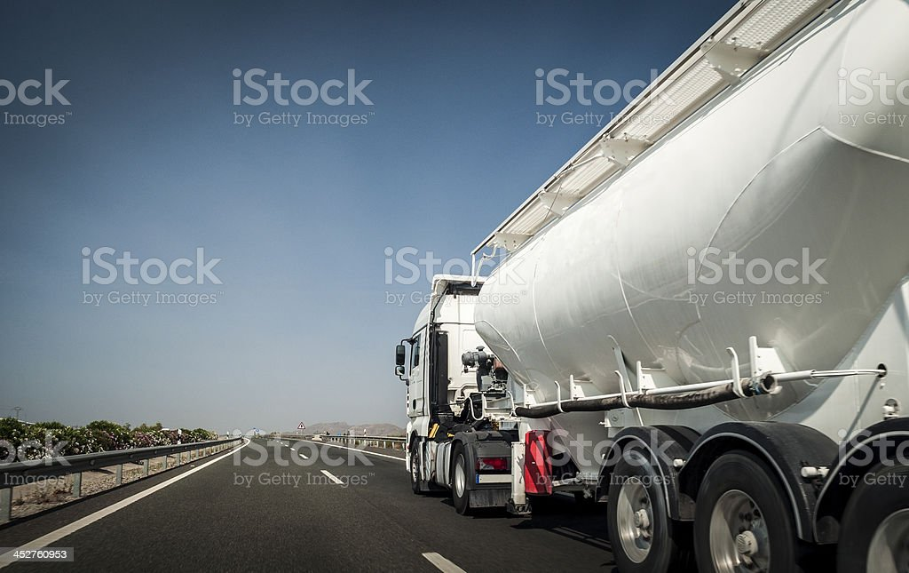 White tanker truck on the freeway stock photo