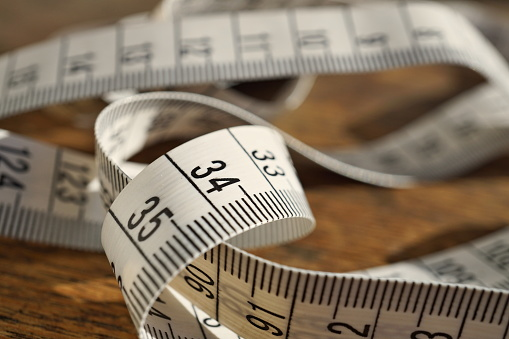 istock White tape measure (tape measuring length in meters and centimeters) 619528488