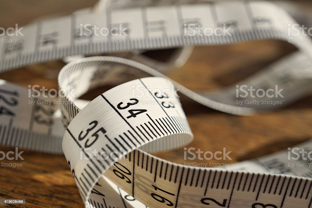 White tape measure (tape measuring length in meters and centimeters) stock photo