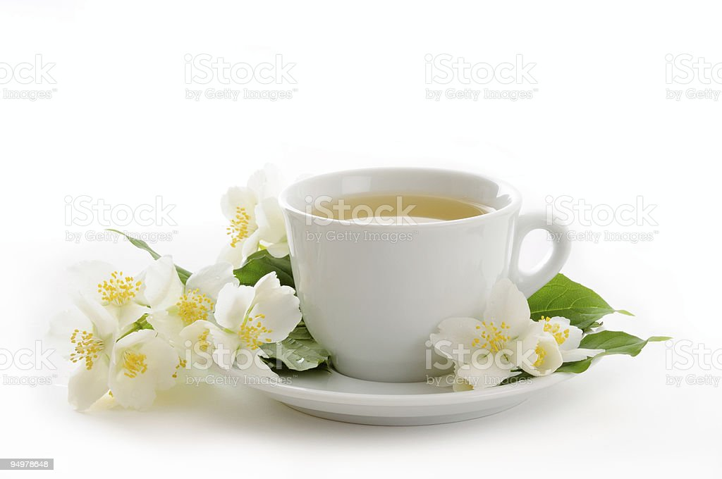 White tea cup and white and yellow flowers royalty-free stock photo