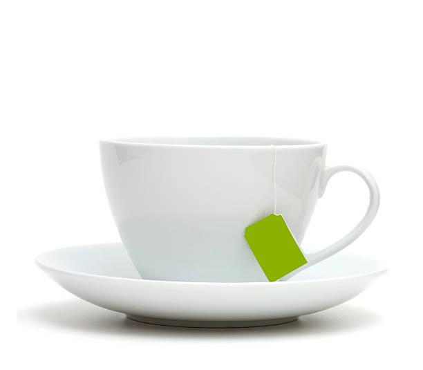 white tea cup on plate with empty label - theekop stockfoto's en -beelden