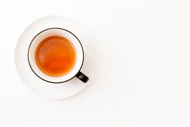 white tea cup over white background, top view - theekop stockfoto's en -beelden